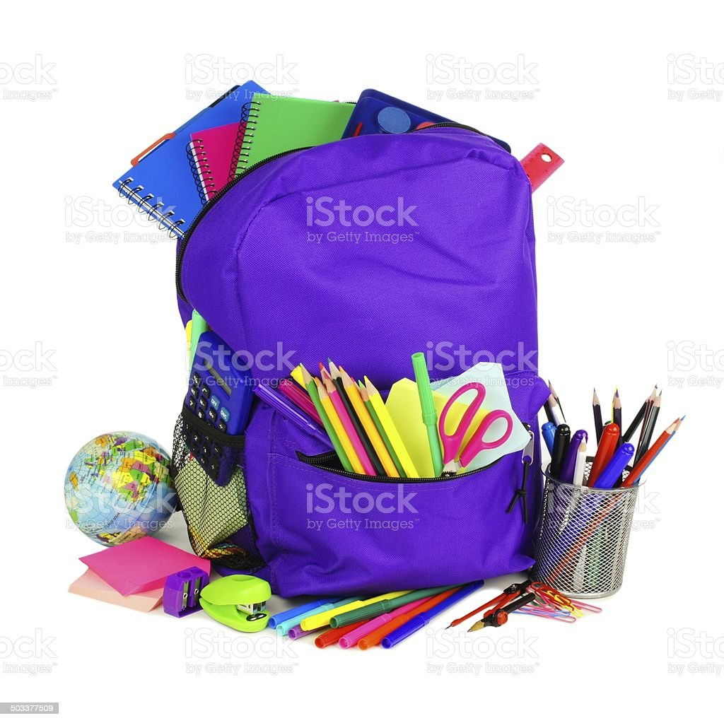 School backpack filled with school supplies stock photo