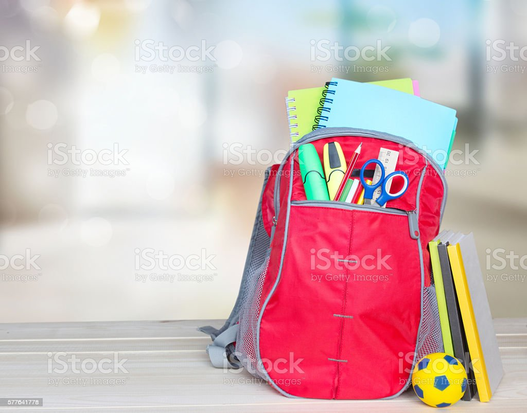 School bag on table indoors background. School supplies. stock photo