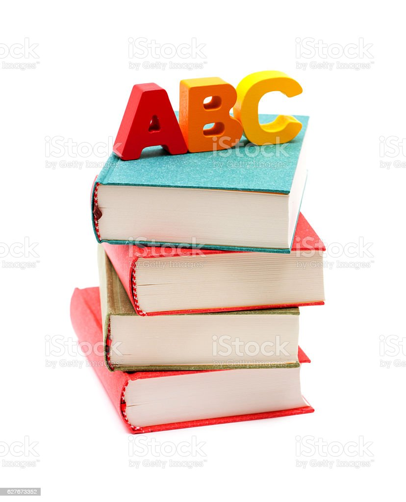 School Books and Alphabet isolated on white background stock photo