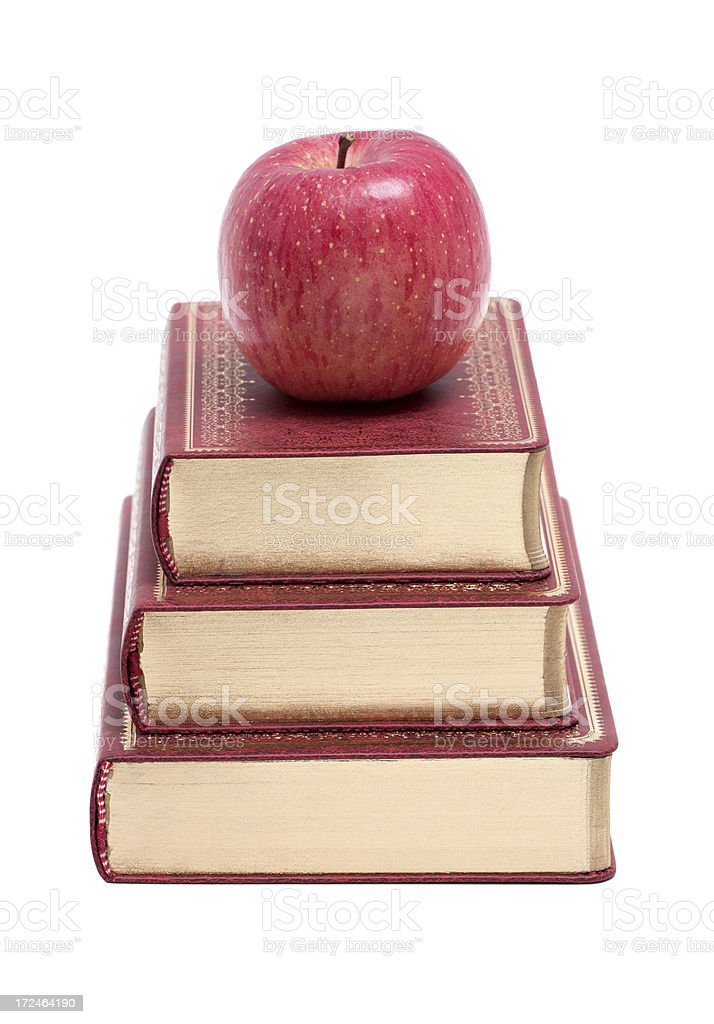 School Books with Apple isolated on white background royalty-free stock photo