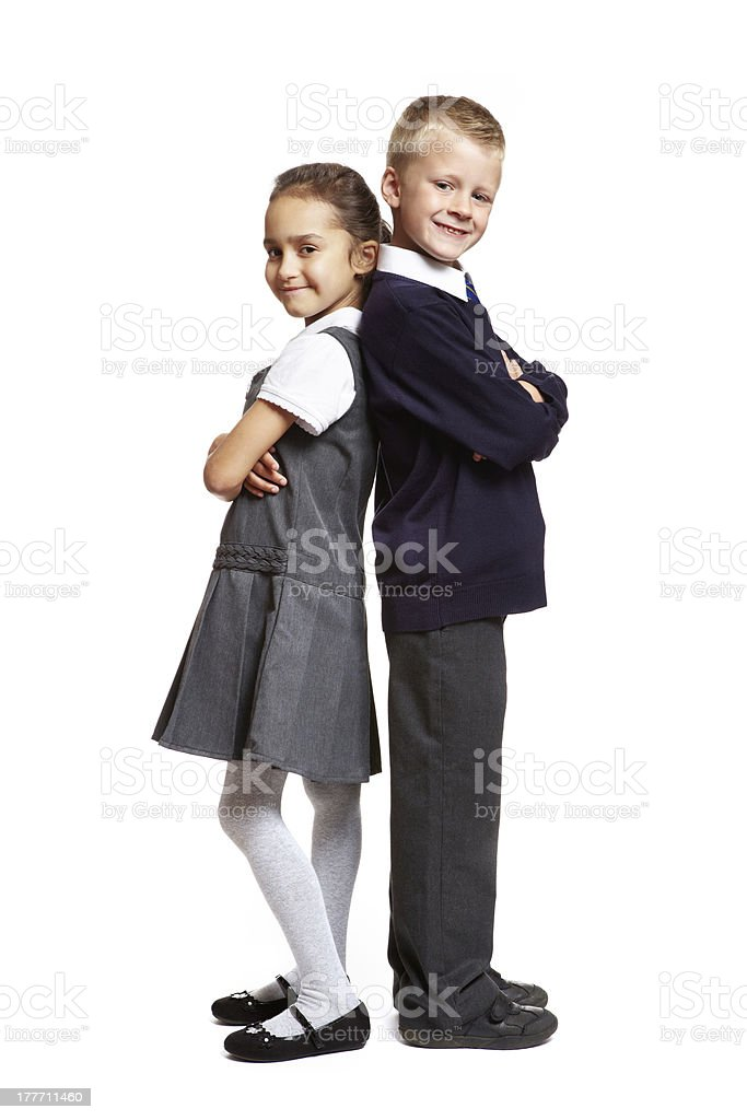 School boy and girl on white background stock photo