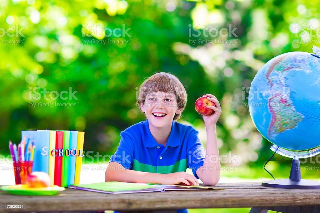 School boy doing homework stock photo