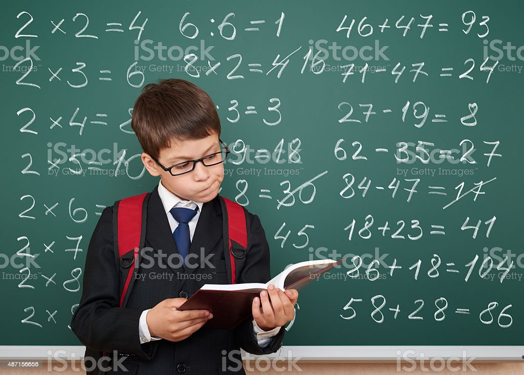 school boy exercise math on board stock photo