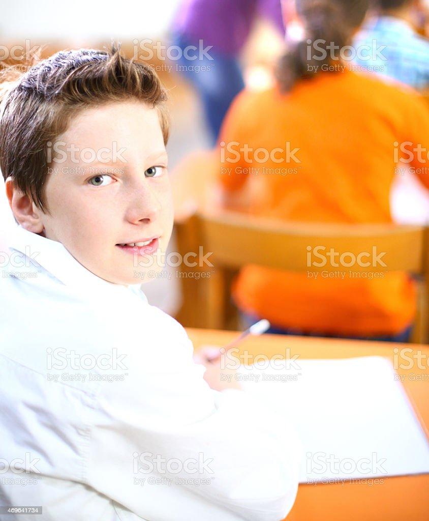 School boy in class. stock photo
