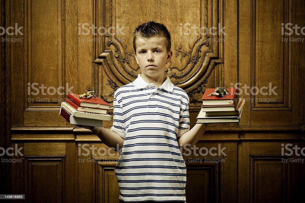 School boy punished holding books stock photo