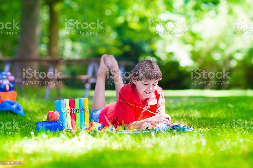 School boy reading a book stock photo