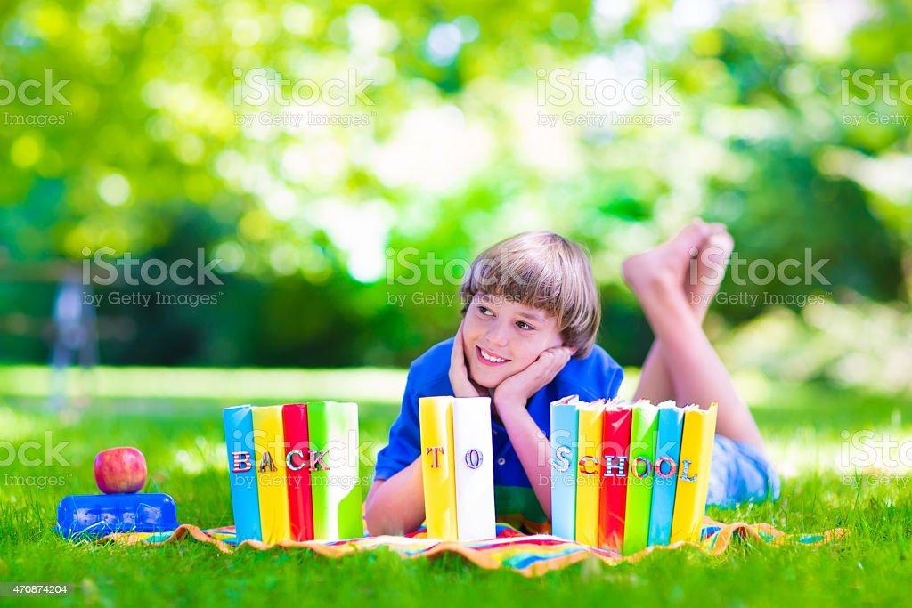 School boy reading books stock photo