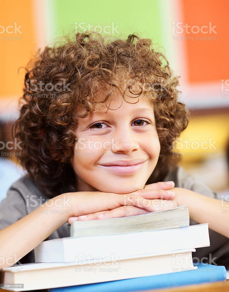 School boy relaxing in his classroom royalty-free stock photo