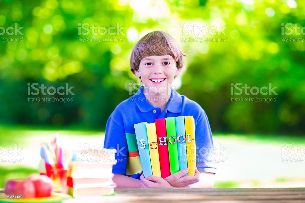 School boy with books stock photo