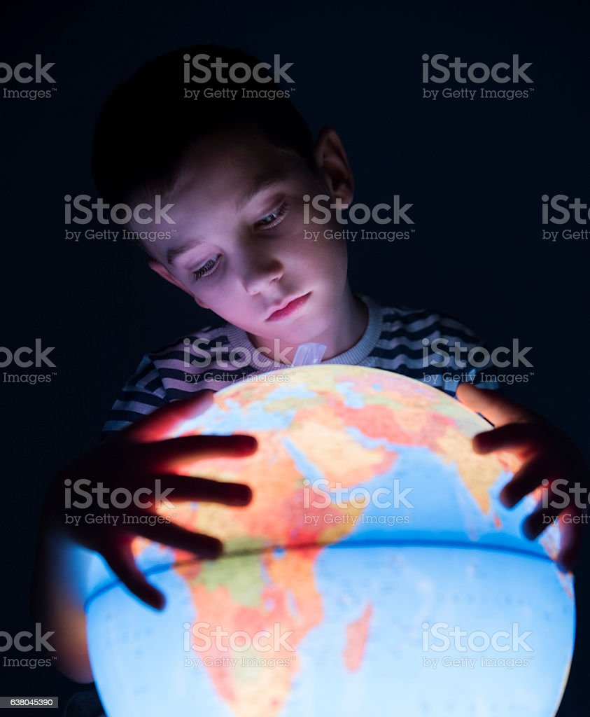 School boy with globe stock photo
