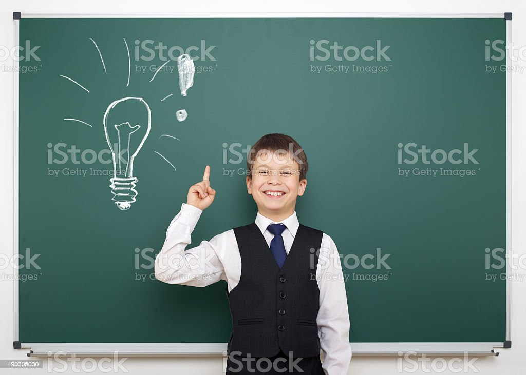 school boy with painted lightbulb having idea stock photo