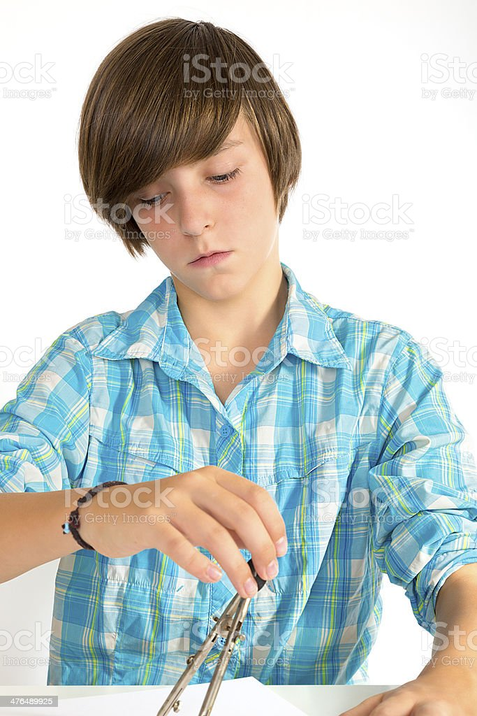 school boy working with a circle, isolated on white royalty-free stock photo