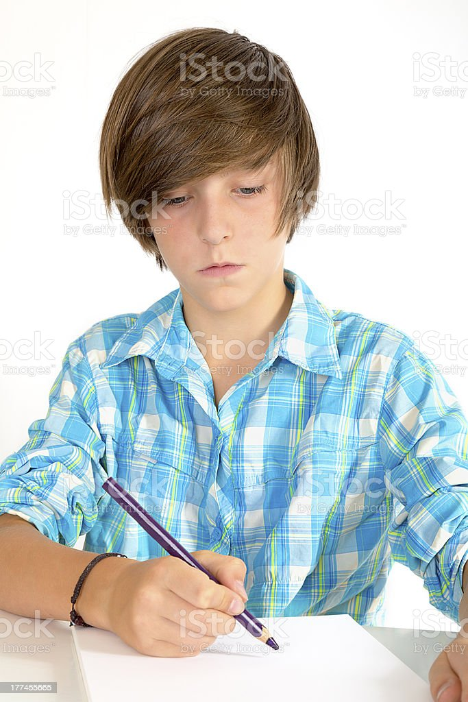 school boy working with a pencil, isolated on white royalty-free stock photo