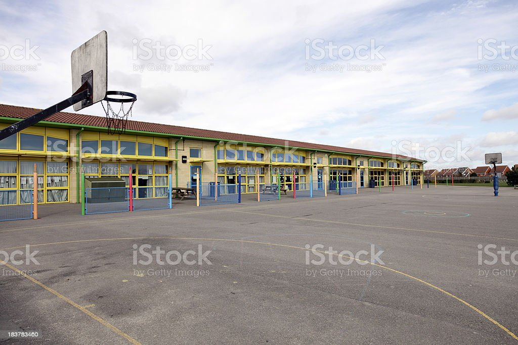 School building and playground stock photo