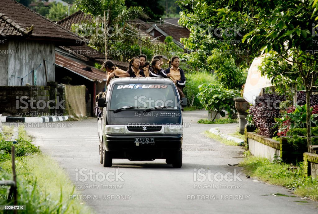 School bus carrying school girls back to their home stock photo