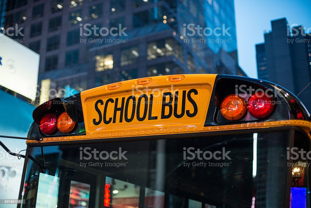 School bus children educational transport at the parking stock photo