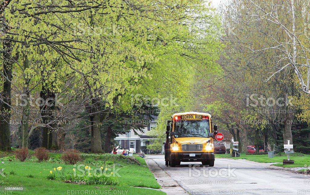 School Bus Stop Gossip on Suburban Street stock photo