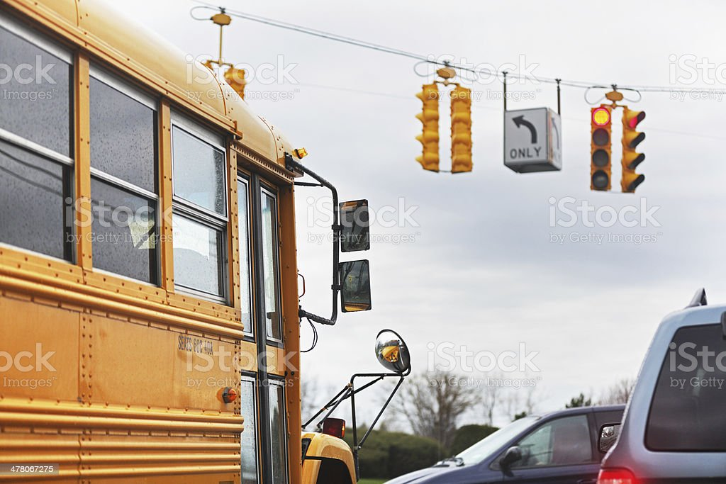 School Bus Stopped at Rainy Red Light stock photo