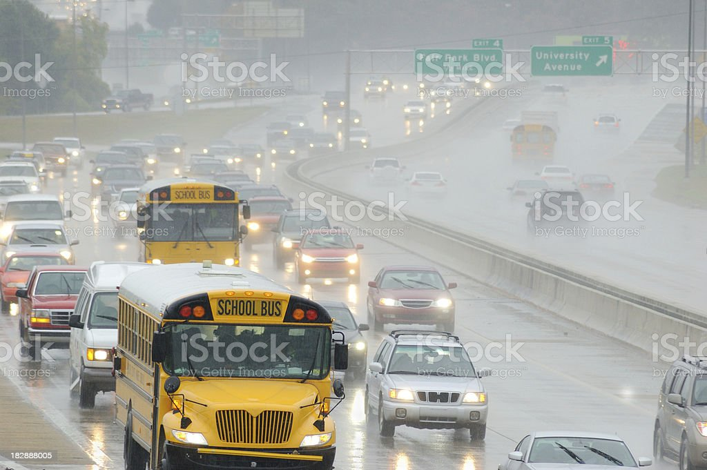 School Buses in Rush Hour Traffic on a Rainy Day royalty-free stock photo