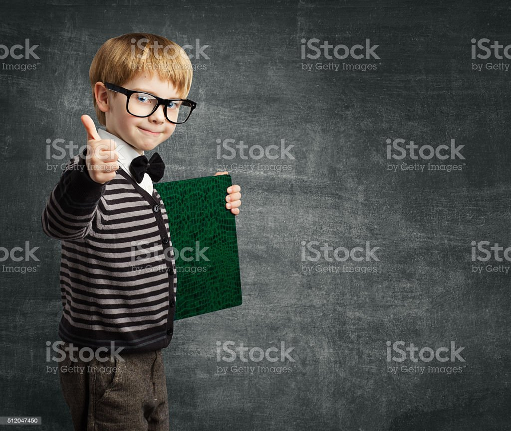 School Child in Glasses Thumbs Up, Kid Boy Hold Book stock photo
