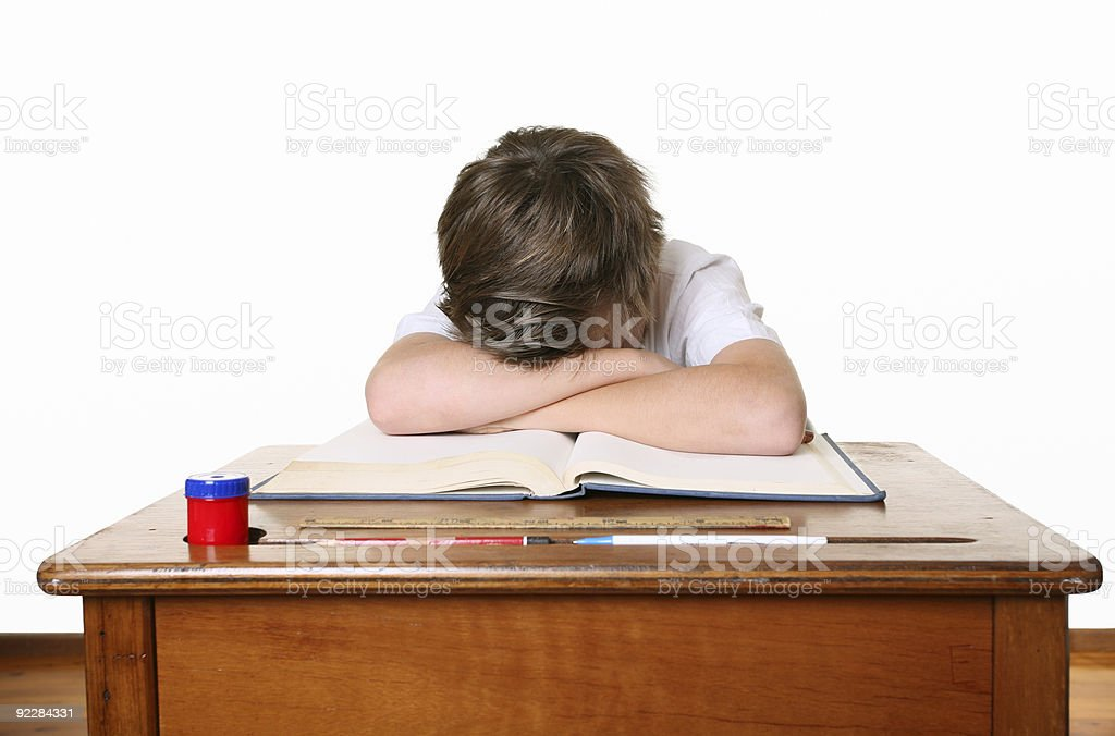 School child with head in hands stock photo
