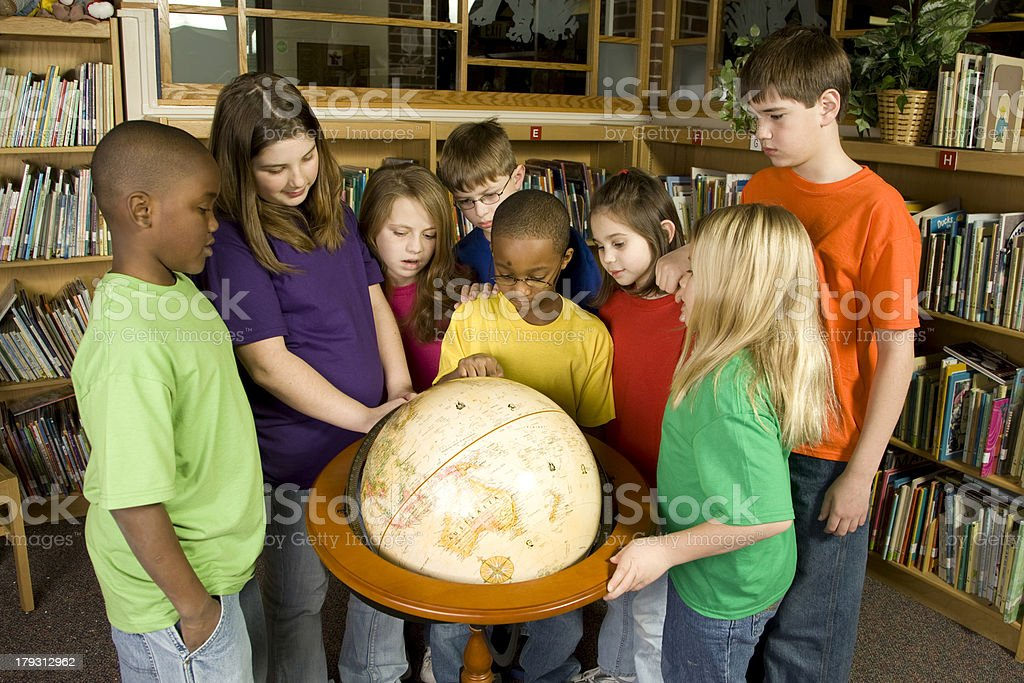 School Children Explore the Globe royalty-free stock photo