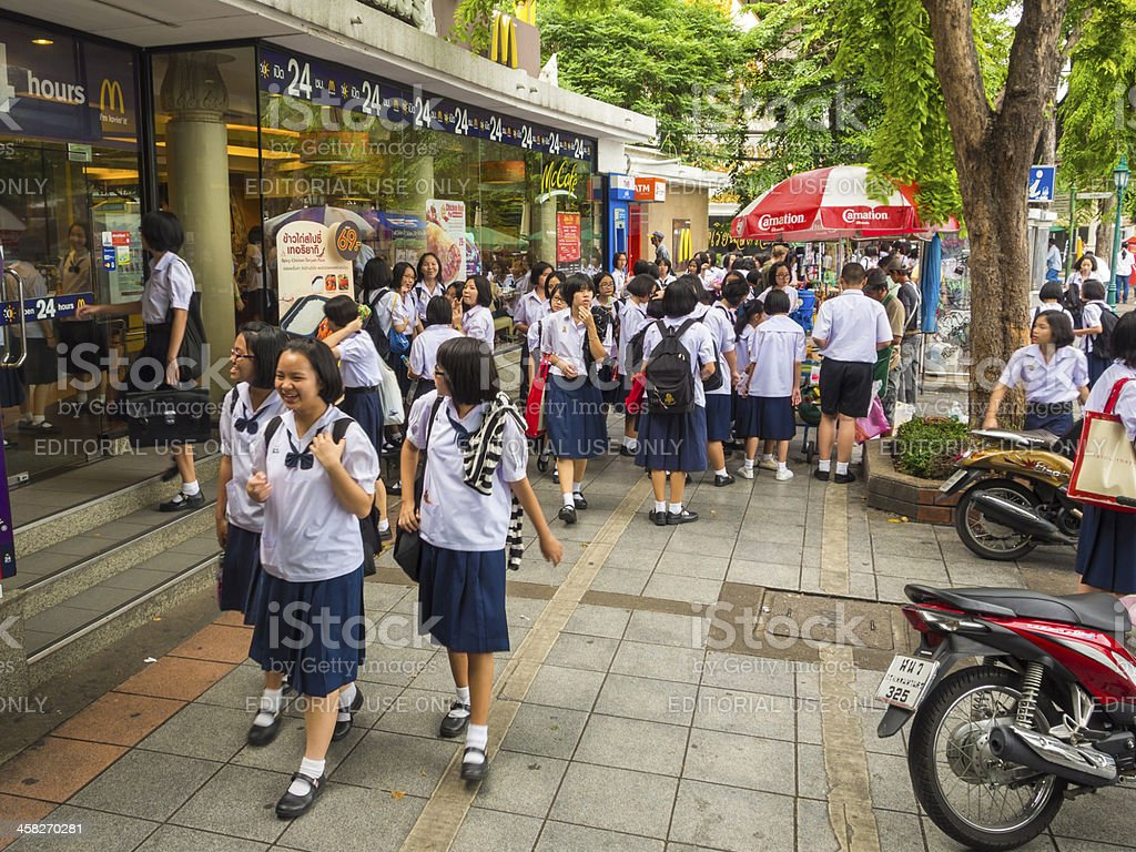 School Children outside Mcdonalds, Thailand royalty-free stock photo