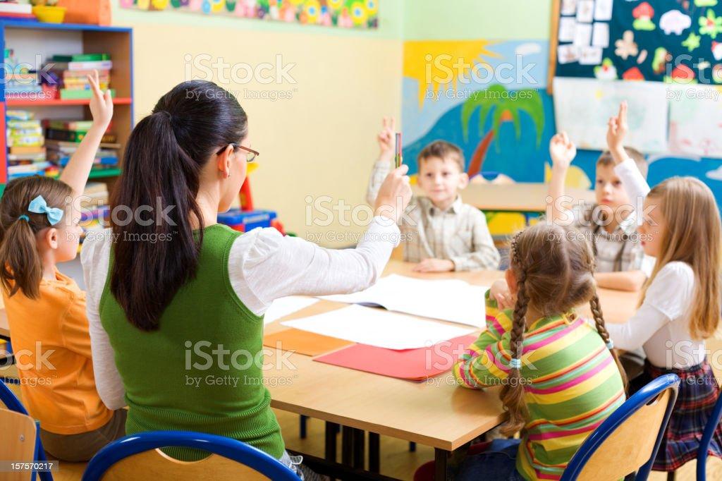 School Children Raising Hands royalty-free stock photo