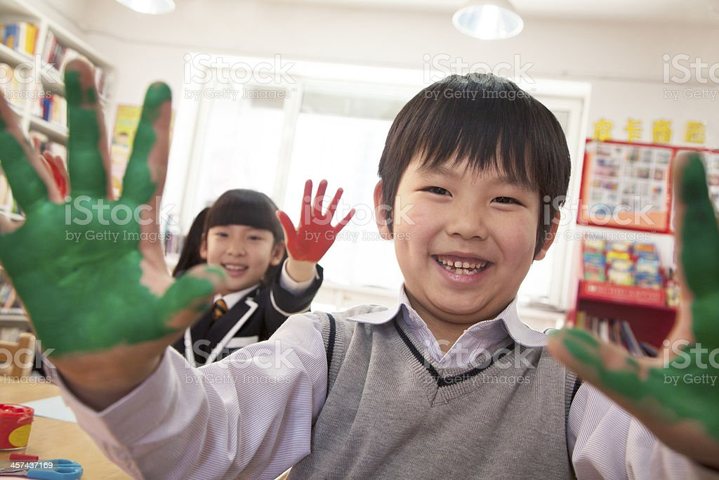 School children showing their hands covered in paint stock photo