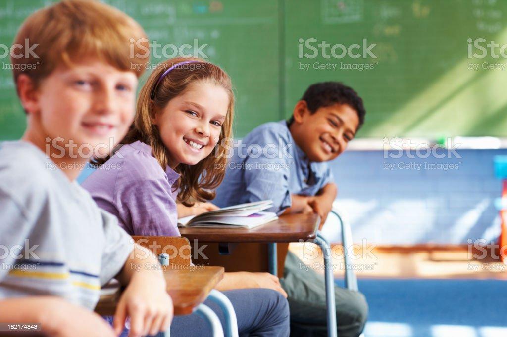 School children sitting in classroom royalty-free stock photo