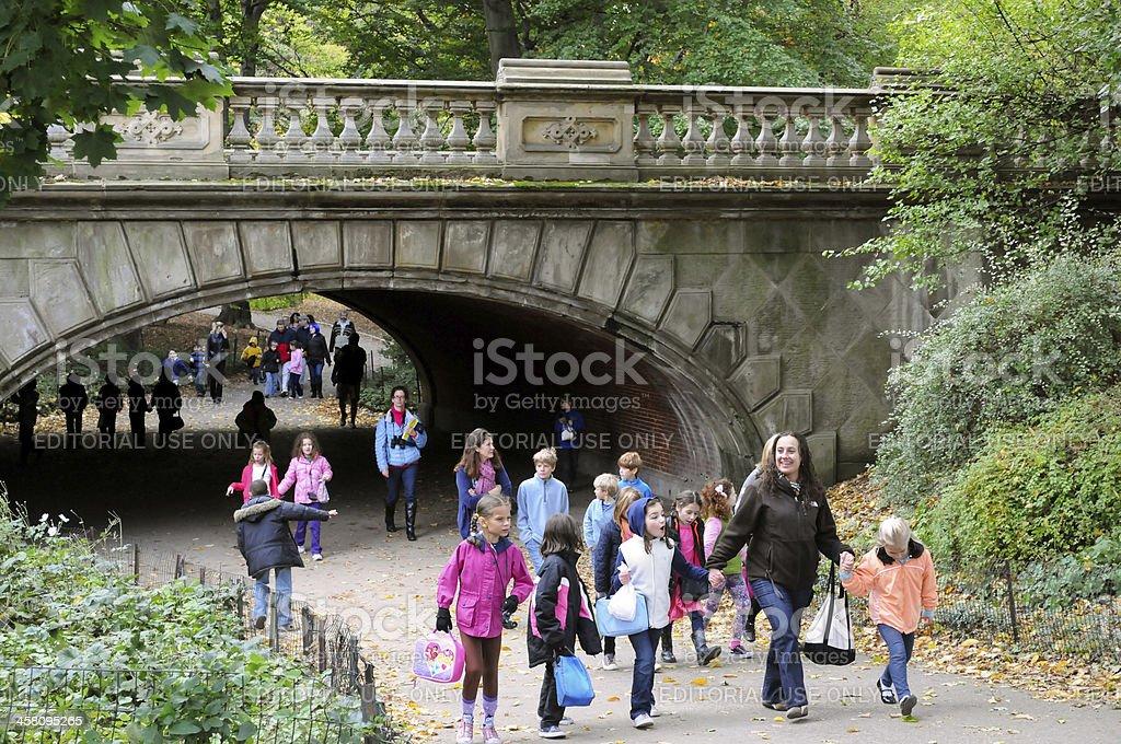 School children walking in Central Park stock photo