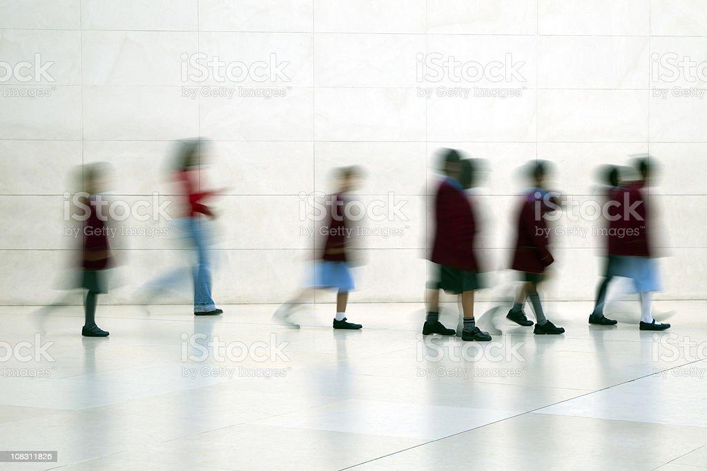 School children walking, motion blur royalty-free stock photo