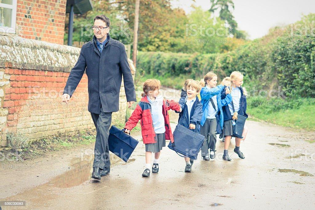 UK School children walking to meet their parents stock photo