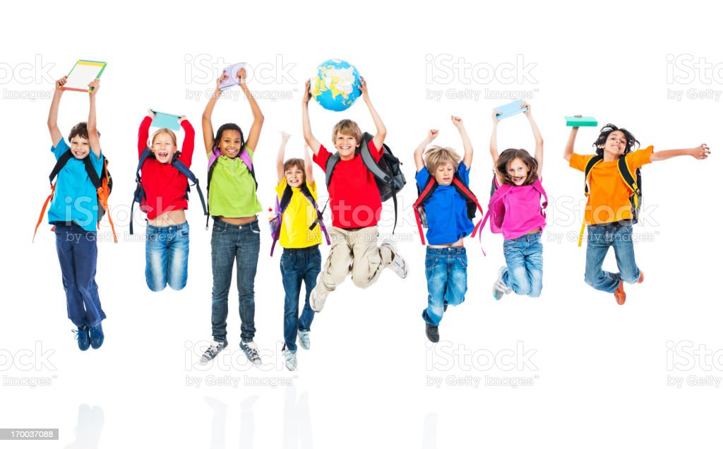 School children with backpacks and books jumping. royalty-free stock photo
