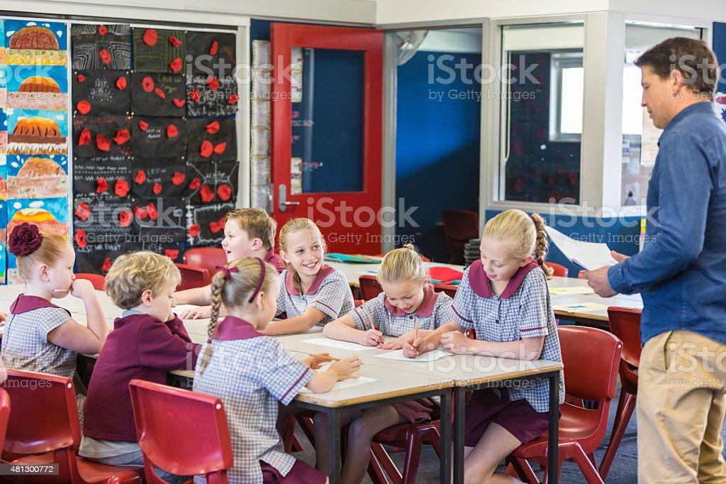 School Children Working in the Classroom stock photo