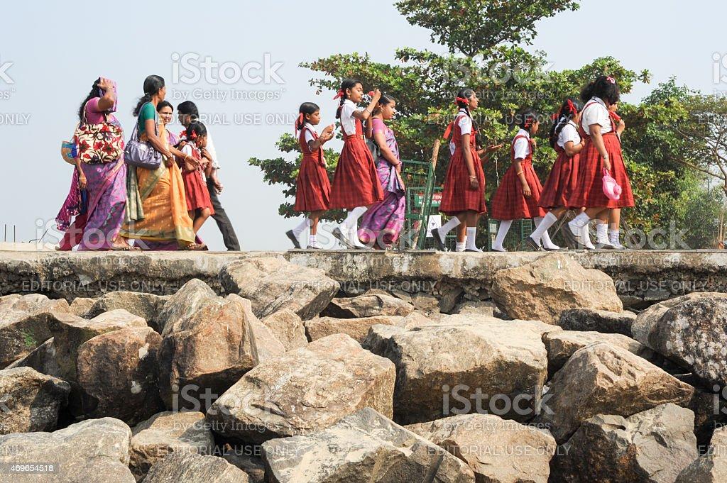 School class in uniform walking in row at Fort Cochin stock photo