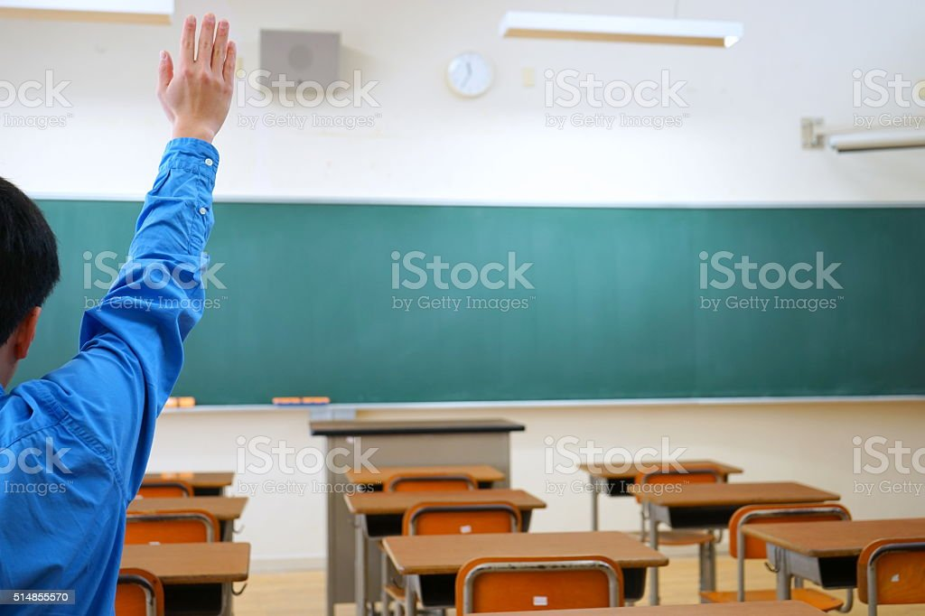 School classroom with school desks and blackboard stock photo