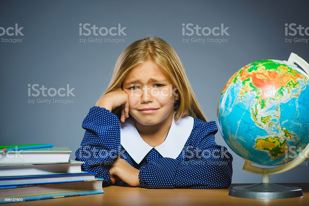 school concept. crying girl with astonished or doubt expression sitting stock photo
