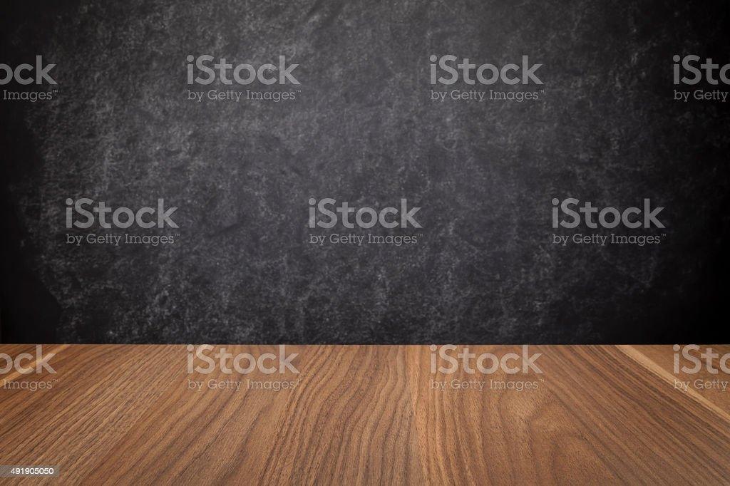 School desk border against black chalkboard background stock photo