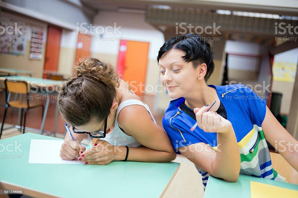 School education scene: cheating at the exam stock photo
