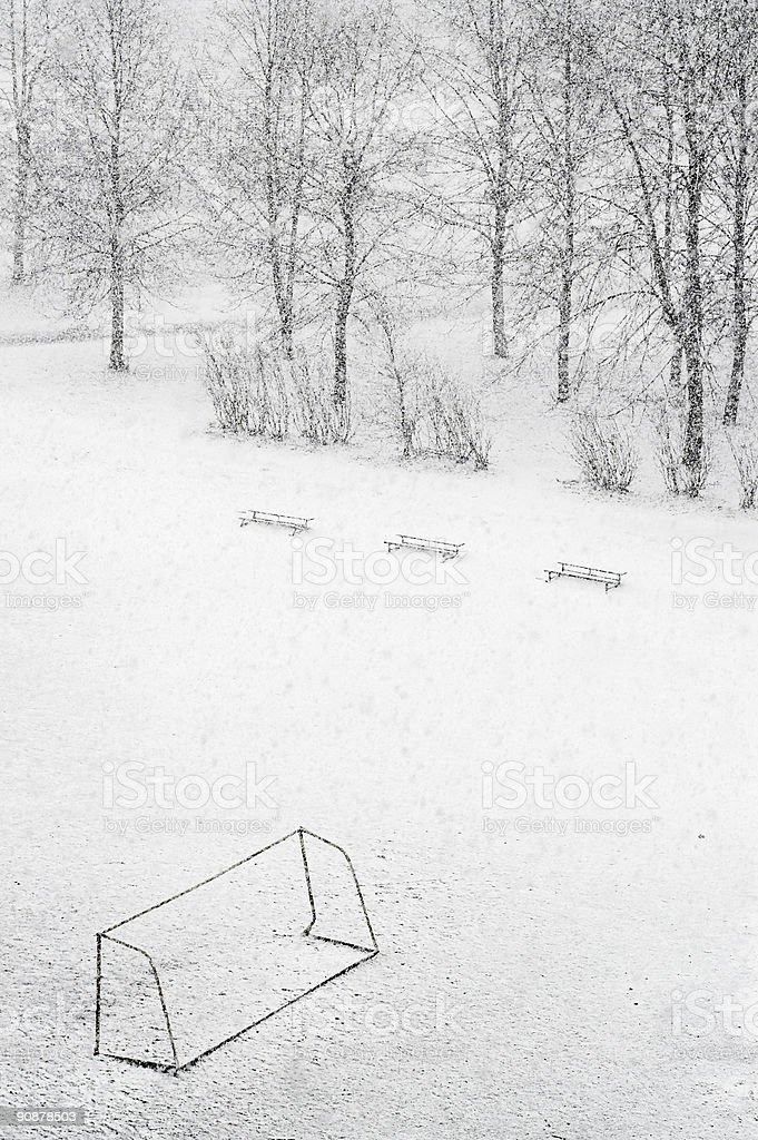 School football ground while snowfalling stock photo