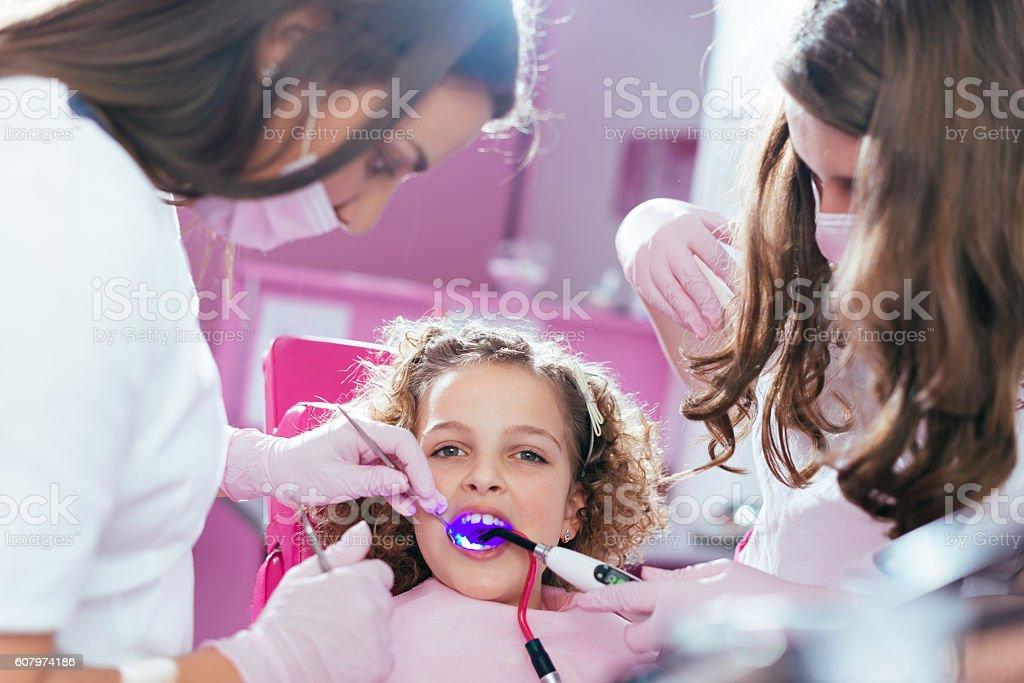 School girl at dentist stock photo