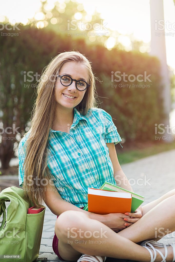 School girl holding textbooks stock photo
