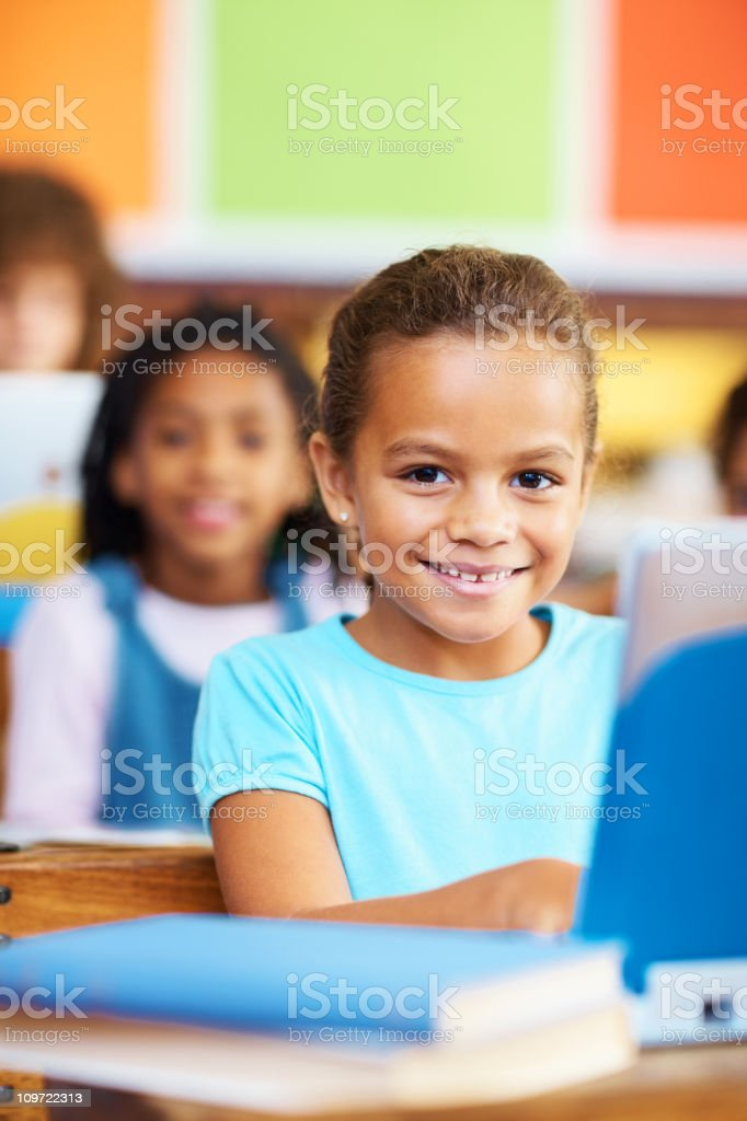 School girl in the classroom using laptop royalty-free stock photo