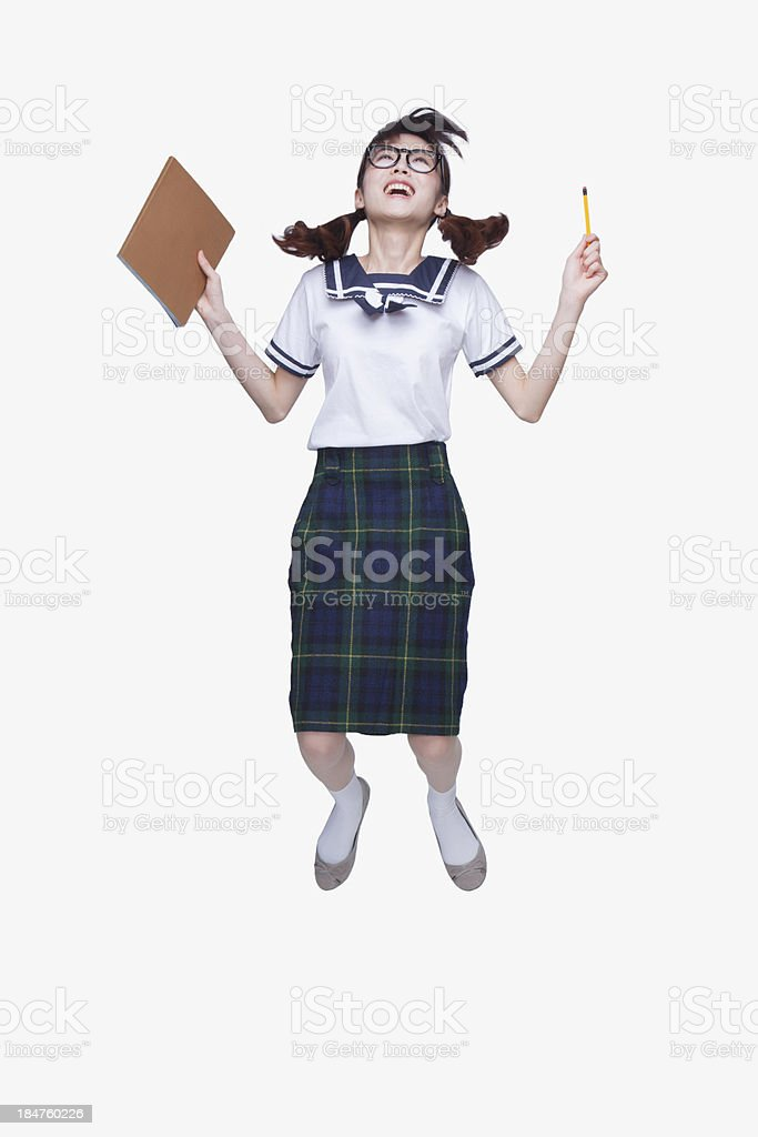 School Girl Jumping stock photo