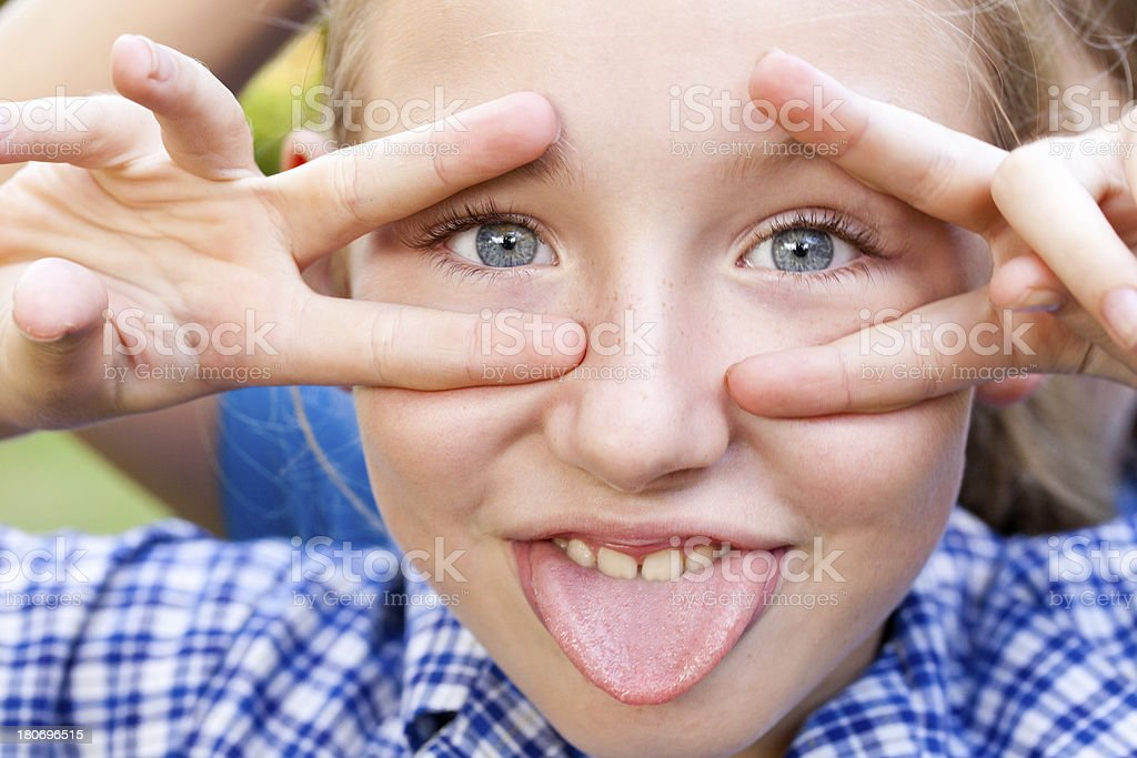 School Girl Making Funny Face in school uniform royalty-free stock photo
