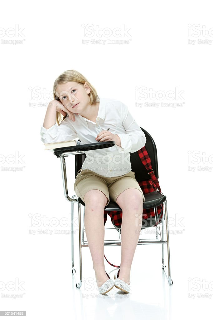 School girl sitting on study chair stock photo