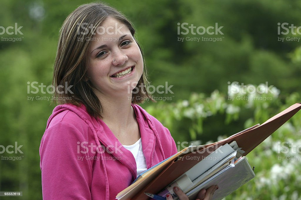 School girl smiling with books royalty-free stock photo