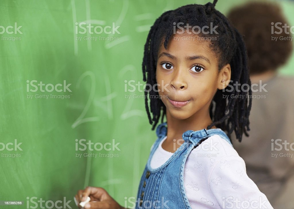 School girl solving maths sums on the board royalty-free stock photo