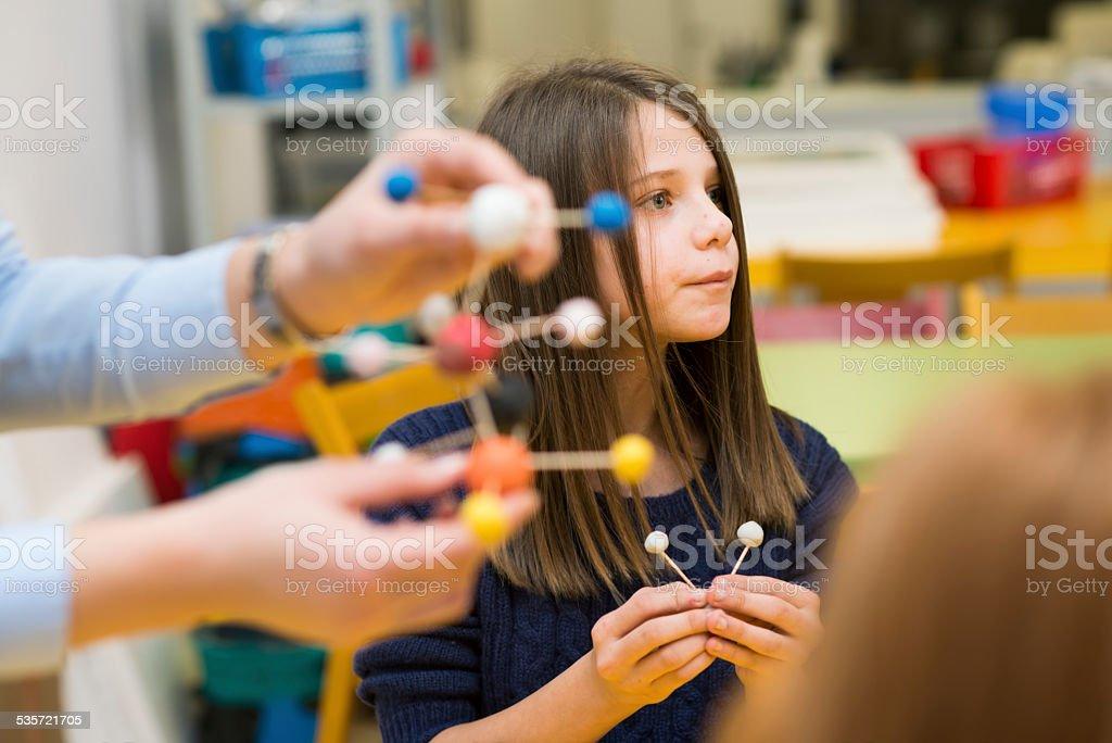 School girl wirh chemical, molecules stock photo